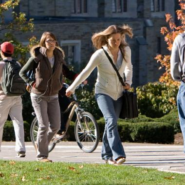 Students walking across campus in fall